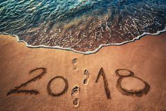 Happy New Year 2018 concept on the sea beach at sunrise. Happy New Year 2018 concept written on the sea beach at sunrise Stock Photography