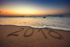 Happy New Year 2018 concept on the sea beach; sunrsie shot. Happy New Year 2018 concept, lettering on the beach. Sea sunrise Royalty Free Stock Photo