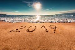 Happy New Year 2019 concept on the sea beach; sunrsie shot stock photos