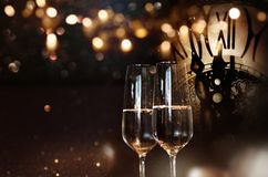 Happy new year with champagne. Happy new year congratulations with champagne and a clock Royalty Free Stock Photography