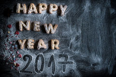 Happy New Year 2017. Cookies on the dark background with blank space