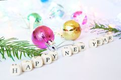 Happy New Year. Cubes with letters on a white surface... royalty free stock image