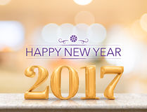 Happy new year 2017 3d rendering new year on marble table top. With blur abstract bokeh background,Holiday greeting card