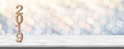 Happy new year 2019 3d rendering wood texture on white marble. Table at soft pastel blue and orange sparkle bokeh light abstract background,mock up banner space royalty free stock photography
