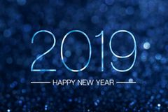 Happy new year 2019 with dark navy blue glitter bokeh light spar. Kling background,Holiday celebration festive greeting card Royalty Free Stock Images