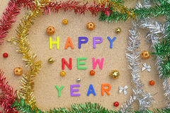Happy new year decoration on brown wooden background Stock Photography