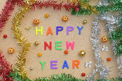 Happy new year decoration on brown wooden background Stock Images