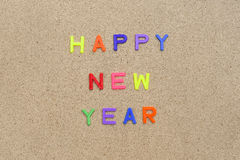 Happy new year decoration on brown wooden background Stock Photos