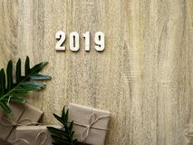 Happy new year 2019 decorative with gift box on wooden stock photo