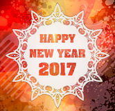 Happy New Year 2017 with decorative white lace pattern. On abstract bright bokeh and lens flare  background in red, yellow, orange colors Stock Photos