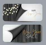 Happy New Year design concept. Gift card or voucher. Black, white and golden balloons on wooden background under torn out sheet of