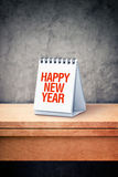 Happy New Year on desk calendar at office table Stock Photos