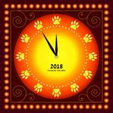 Happy New Year. The dial of the watch with traces of the dog`s paws instead of figures. Card. Happy New Year. The dial of the watch with traces of the dog`s paws Stock Image