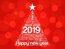 2019 Happy New Year in different languages. Celebration word cloud greeting card in the shape of a christmas tree royalty free illustration