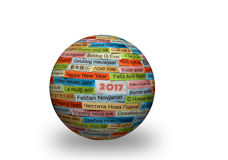Happy New Year on different languages on 3d sphere. Happy New Year Word Cloud printed on colorful paper on 3d ball different languages royalty free stock images