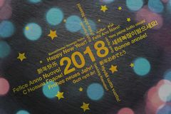 Happy New Year in different languages greeting card concept. With bokeh lights vector illustration