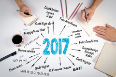 2017 Happy New Year in different languages. The meeting at the w. Hite office table vector illustration