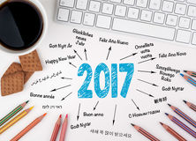 2017 Happy New Year in different languages. White office desk.  Stock Image