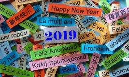 Happy New Year on different languages. Happy New Year 2019 Word Cloud printed on colorful paper different languages stock photography