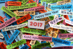 Happy New Year on  different languages. Happy New Year  Word Cloud printed on colorful paper different languages Stock Image