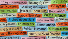 Happy New Year on  different languages. Happy New Year  Word Cloud printed on colorful paper different languages Royalty Free Stock Image
