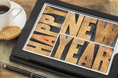 Happy new year on digital tablet Royalty Free Stock Photos