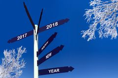 Happy new year 2018 on direction panels, snowy trees Stock Photos