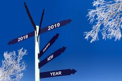 Happy new year 2019 on direction signs, snowy trees. Happy new year 2019 on direction signs with snowy trees royalty free stock image