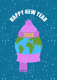 Happy new year. Earth in winter. Planet in knitted CAP and a wa Royalty Free Stock Photography