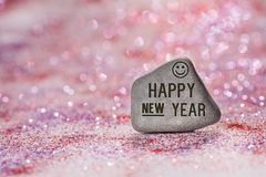Happy new year engrave on stone royalty free stock photo