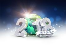 Happy New Year 2018 environmental greetings for change. Greetings and silver New Year date 2018, composed with a green planet earth, on a blurry blue background Royalty Free Stock Photos