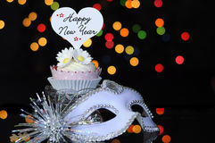 Happy New Year Eve party with cupcake and party masquerade mask Royalty Free Stock Photo