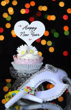 Happy New Year Eve party with cupcake and party masquerade mask Royalty Free Stock Photos
