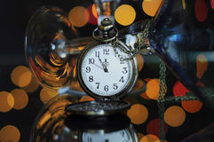Happy New Year Eve party with pocket watch with five to midnight time Stock Photo