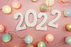 Happy New Year 2022 festive background with space on pink background