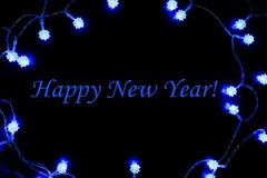 Happy New Year Blue Lights Frame. Happy New Year with Festive Frame made of Blue Lights Stock Photo