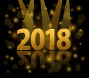 2018 happy new year festive gold 3d numbers under the spotlight. With bokeh, glowing shiny stars over black background Royalty Free Stock Image