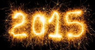 Happy new year, fiery numbers. On a dark background Royalty Free Stock Photography