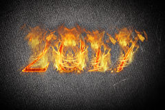 Happy new year 2017 - figures in flame. Collage.  Royalty Free Stock Image