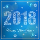 Happy New Year 2018. Figures made of snowflakes. Blue background with bokeh. And square frame Stock Image
