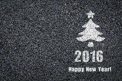 Happy new year and fir-tree written on an asphalt road background Royalty Free Stock Photo