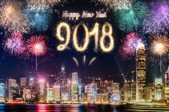Happy new year 2018 firework over cityscape building near sea at Royalty Free Stock Image