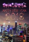 2018 Happy new year firework Sparkle with cityscape of Singapore. 2018 Happy new year firework Sparkle with cityscape view of Singapore city at night Stock Photo