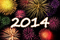 Happy new year 2014. With fireworks against black sky Royalty Free Stock Images