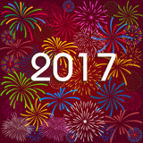 Happy New Year 2017 with fireworks background.