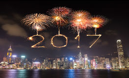 2017 Happy New Year Fireworks celebrating over Hong Kong city. At night, view from Victoria Harbour Stock Photo