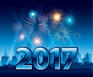 Happy New Year 2017 with fireworks and city in background. Happy New Year 2017 with fireworks and a city in background Royalty Free Stock Photos