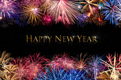 Happy New Year Fireworks Display. Black background with a border of Fireworks royalty free stock photo