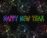 Happy New Year fireworks. Happy New Year greetings made with colorful sparkles and fireworks Royalty Free Stock Photo