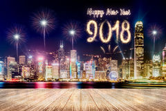 Happy new year 2018 fireworks over cityscape at night with empty Royalty Free Stock Images